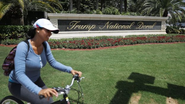 A sign reading Trump National Doral is seen on the grounds of the golf course owned by Republican presidential candidate Donald Trump on June 1, 2016 in Doral, Florida. Reports indicate that a PGA Tour event that has been held at the Trump National Doral since 1961 is heading to Mexico City in 2017