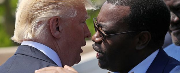 Akinwumi Adesina (R) and Donald Trump