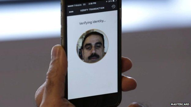 Ajay Bhalla demonstrating facial recognition
