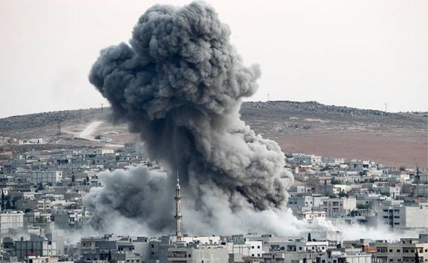 Heavy smoke rises following an airstrike by the US-led coalition aircraft in Kobani, Syria, during fighting between Syrian Kurds and the militants of Islamic State group