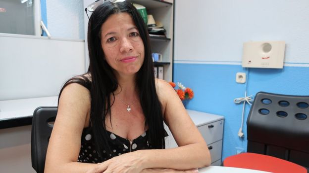 Maria Eugenia Carrillo sitting in an office space