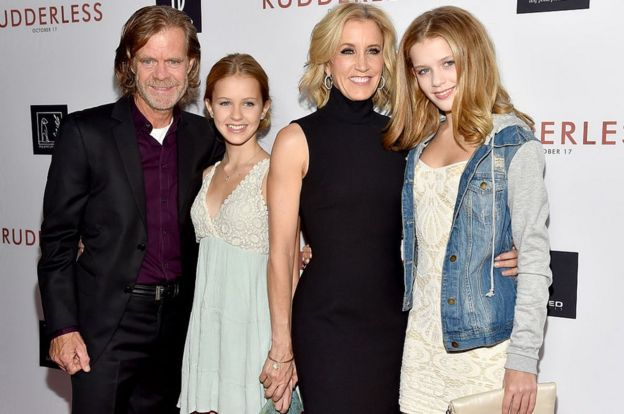 William H Macy, Felicity Huffman and the couple's two daughters at a 2014 movie premiere.