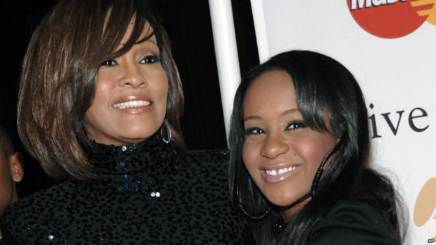 Singer Whitney Houston and daughter Bobbi Kristina Brown arrive at an event in Beverly Hills, California. Feb 2011.