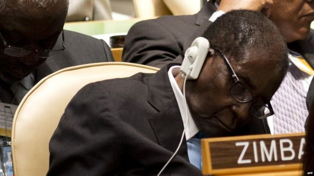 President Mugabe slouches in chair with eyes closed at the UN General Assembly
