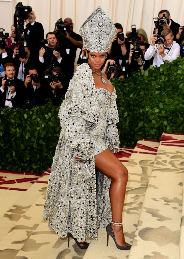Rihanna wears a papal-inspired gown in honour of this year's theme.