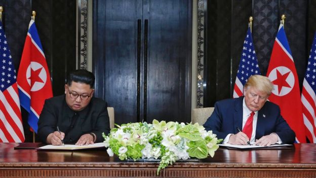 North Korean leader Kim Jong-un (L) with US President Donald Trump (R) during their historic summit on Sentosa island, Singapore, on 12 June 2018