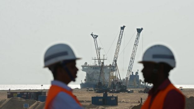 Pumps dredge sand to reclaim land at the site of a Chinese-funded $1.4 billion reclamation next to Colombo's main sea port on January 2, 2018.