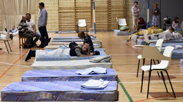 People prepare to spend the night at the Manacor's Miguel Angel Nadal sports centre after they were evacuated due to flash flooding in Sant Llorenc des Cardassar, Mallorca, Spain, 9 October 2018