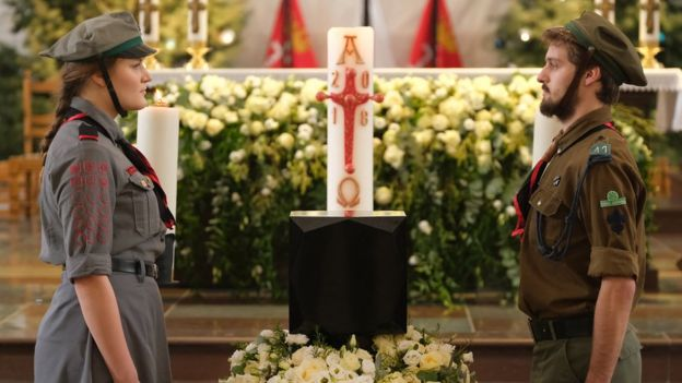 Scouts stand at the urn of Pawel Adamowicz prior to his funeral in St Mary's Church in Gdansk, Poland, 19 January 2019