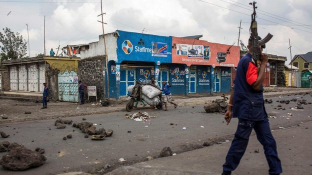 Congolese National Police patrol the street on December 28, 2018 at Majengo in Goma, in North Kivu province, where presidential election vote has been postponed until March
