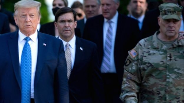 Gen Milley (R) was on the walk with the president and Defence Secretary Mark Esper (C)