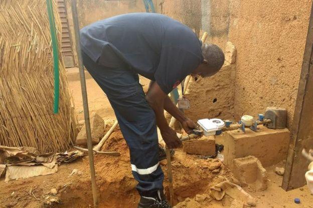 Engineer installing water meter