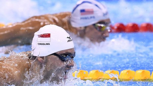 Singapore's Joseph Schooling and USA's Michael Phelps compete in a Men's 100m Butterfly heat