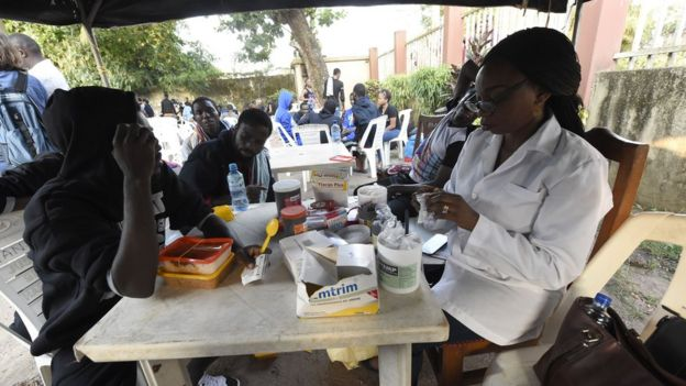 Migrants see health officials shortly after returning from Libya in Benin City, Nigeria