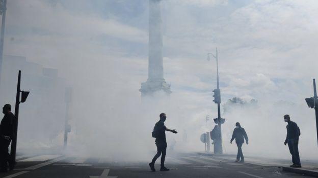 Riot police using tear gas