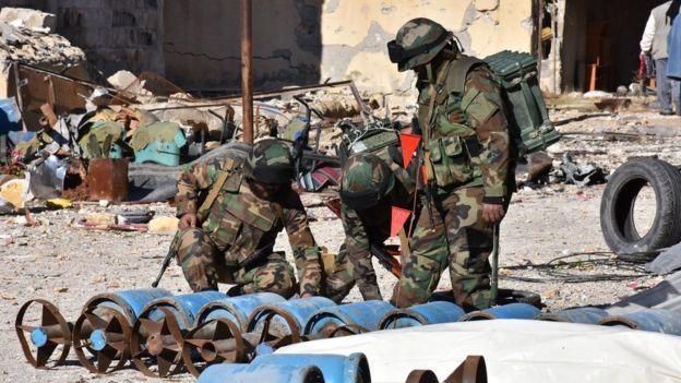 Government troops inspect home-made rebel rockets in recaptured eastern Aleppo - 6 December