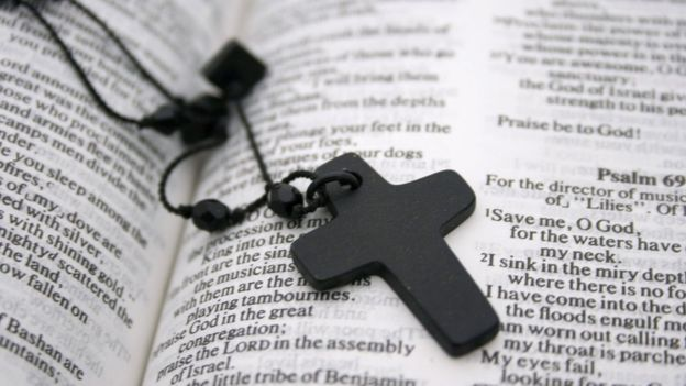 The Bible with a crucifix