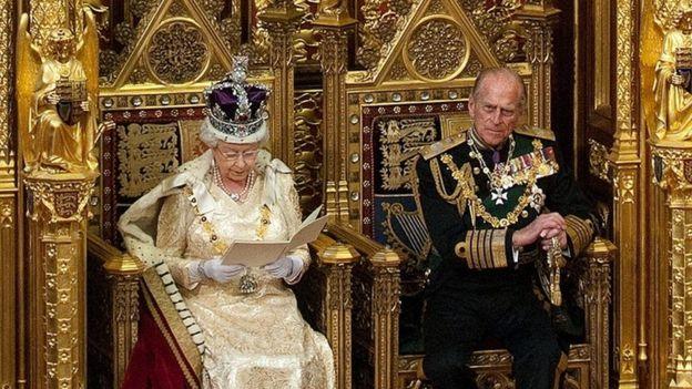 Queen Elizabeth II giving her speech from a throne