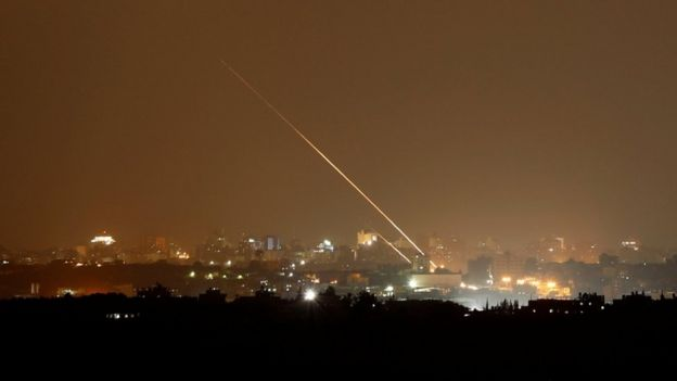 Streaks of light are pictured as rockets are launched from the northern Gaza Strip towards Israel, as seen from Sderot, Israe