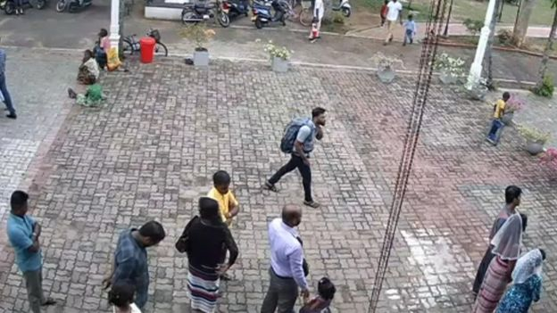 "This still image taken from Sri Lankan closed-circuit TV on April 21, 2019, a suspected bomber (C) with backpack on his way to enter St. Sebastian""s Church in Negombo,"