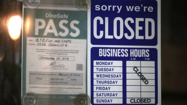 A business in Toronto shows a closed sign even as Ontario begins to slowly emerge from lockdown