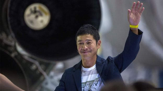 Japanese billionaire Yusaku Maezawa speaks near a Falcon 9 rocket during the announcement by Elon Musk to be the first private passenger who will fly around the Moon, 17 September 2018