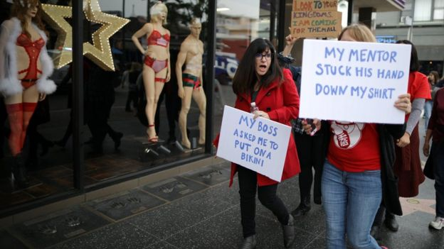 Marchers hold placards on Hollywood's Walk of Fame on Sunday