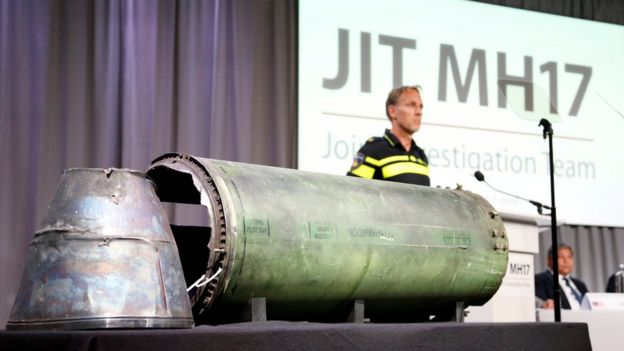 A damaged missile is displayed during a news conference by members of the Joint Investigation Team, comprising the authorities from Australia, Belgium, Malaysia, the Netherlands and Ukraine who present interim results in the ongoing investigation of the 2014 MH17