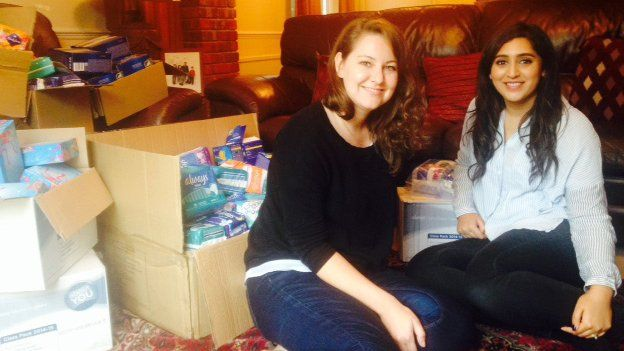 Sanya and Sophie with the products they have collected