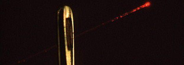 optical fibre passing through the eye of a needle