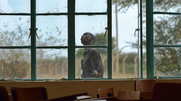 A man walks past bullet-shattered windows at Garissa University (file photo)