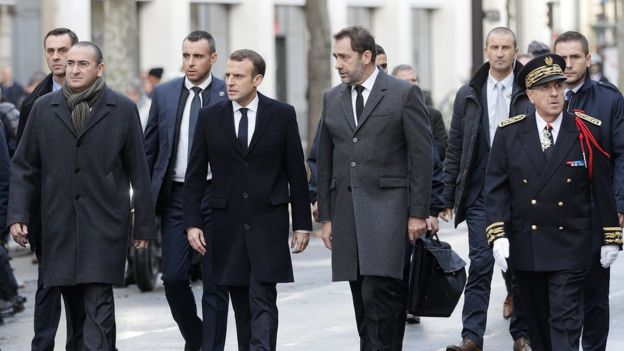 President Macron with Interior Minister Christophe Castaner and Paris police prefect Michel Delpuech (R) walk the streets of Paris in the aftermath of riots