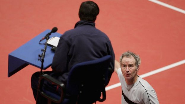 John McEnroe disputes a line call with an umpire in 2005