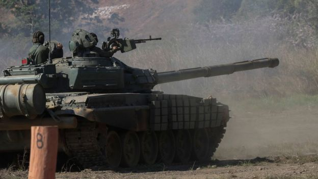 Handout picture released by the Venezuelan presidency showing a Russian-made T72 tank taking part in military exercises at Fort Paramacay in Naguanagua, Carabobo State, Venezuela, on January 27, 2019