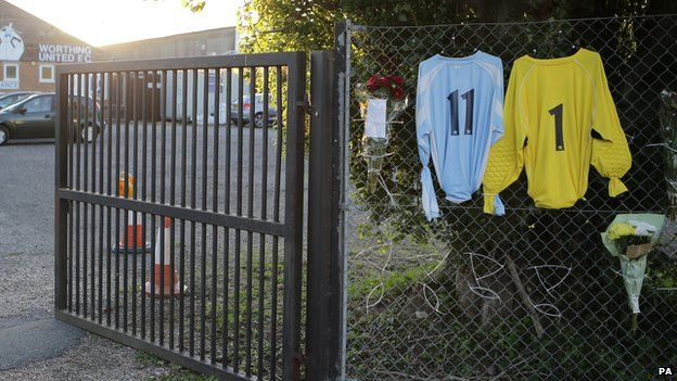 Two shirts and floral tributes outside Worthing United Football Club to Shoreham Airshow crash victims Matthew Grimstone and Jacob Schilt