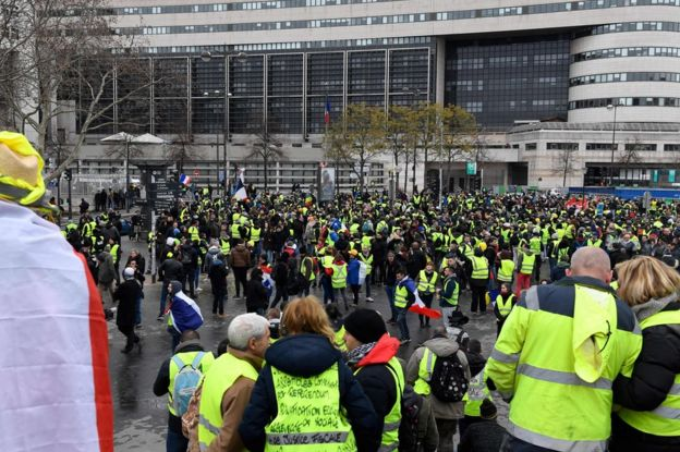 People wearing yellow vest gather in Bercy, in front of the French Ministry for the Economy and Finance, in Paris, on 12 January 2019