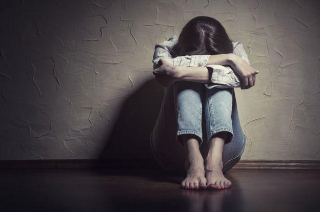 Mujer víctima de abuso.
