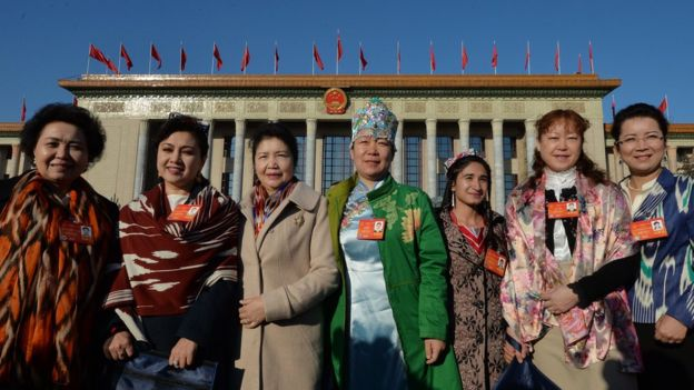 Chinese Uighur delegates from Xinjiang province arrive for the first session of the National People's Congress at the Great Hall of the People in Beijing on March 5, 2014.