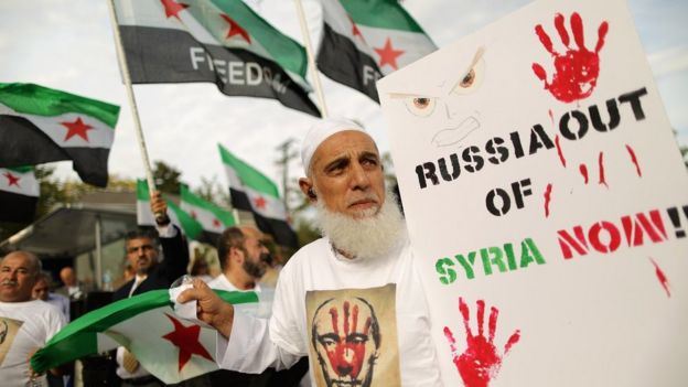 Syrian Americans and supporters of the Syrian people demonstrate against Russia's military build up and action in Syria