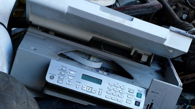 A printer at a landfill