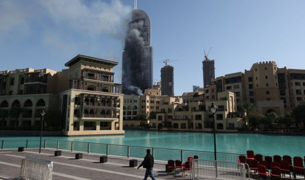 Smoke billows from the Address Downtown Hotel in Dubai, 1 January, 2016