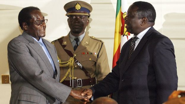 Mugabe and Tsvangirai shake hands in 2008