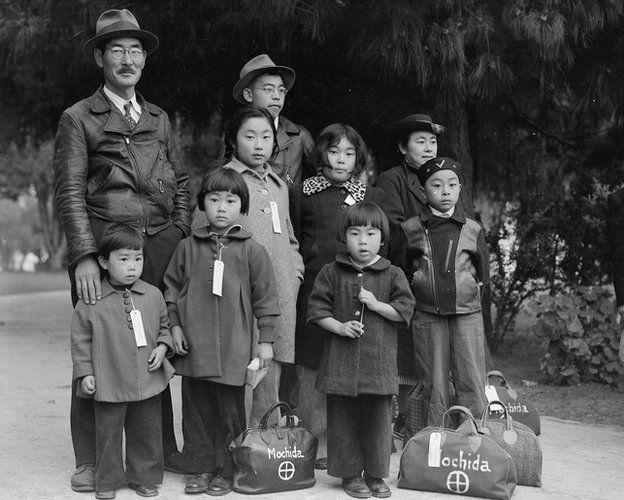 Members of the Mochida family awaiting evacuation bus.