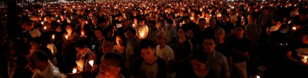 People attend a candlelight vigil at Victoria Park in Hong Kong