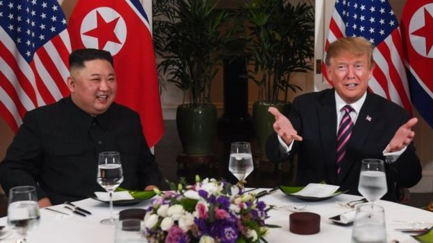 US President Donald Trump (R) and North Korea's leader Kim Jong Un sit for a dinner at the Sofitel Legend Metropole hotel in Hanoi on February 27, 2019.
