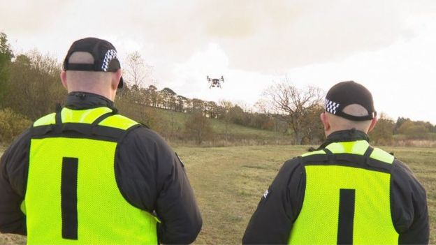 two police officers operate the drone and the data recognition