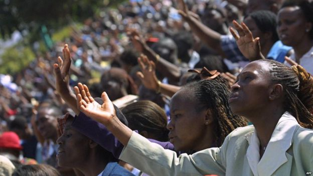Worshipers raise their hands 01, October 2005 during a gospel meeting by visiting US Bishop, Thomas Dexter Jakes in Nairobi , Kenya