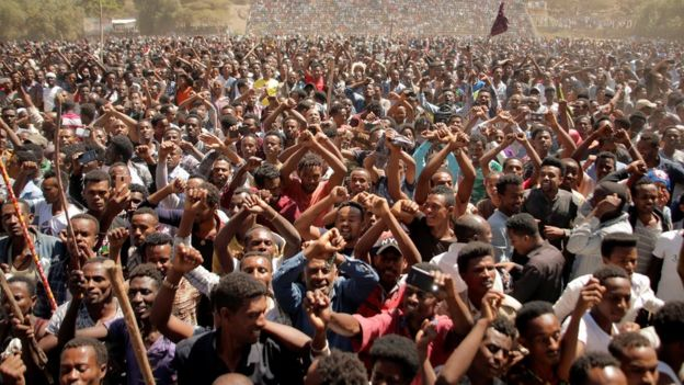 "Supporters of Bekele Gerba, secretary general of the Oromo Federalist Congress (OFC), chant slogans to celebrate Gerba""s release from prison, in Adama, Oromia Region, Ethiopia February 14, 2018"