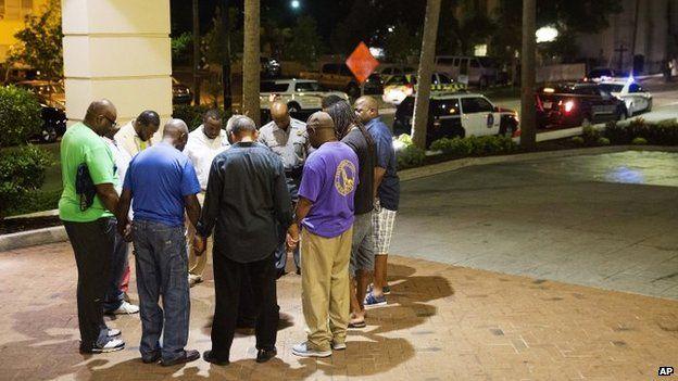 Worshippers pray in Charleston