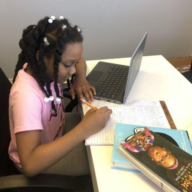 Kellyse Brown, 9, works at her desk